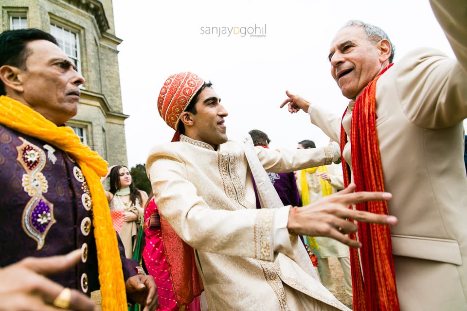 Groom dancing with father