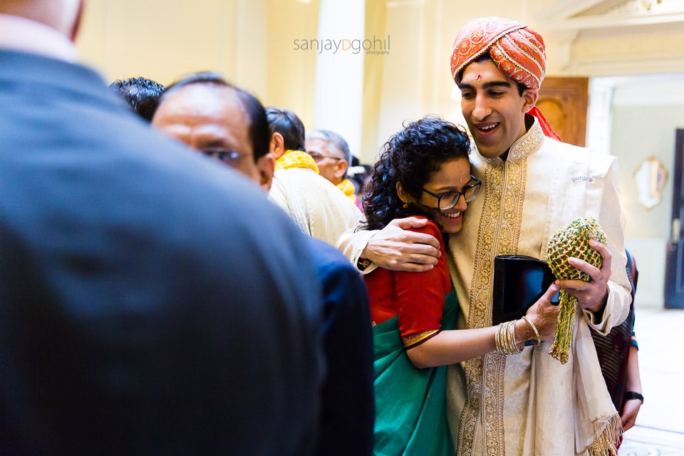 Asian Wedding groom smiling indside hedsor house
