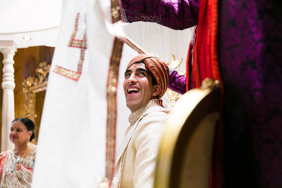 Wedding groom behind antaphat