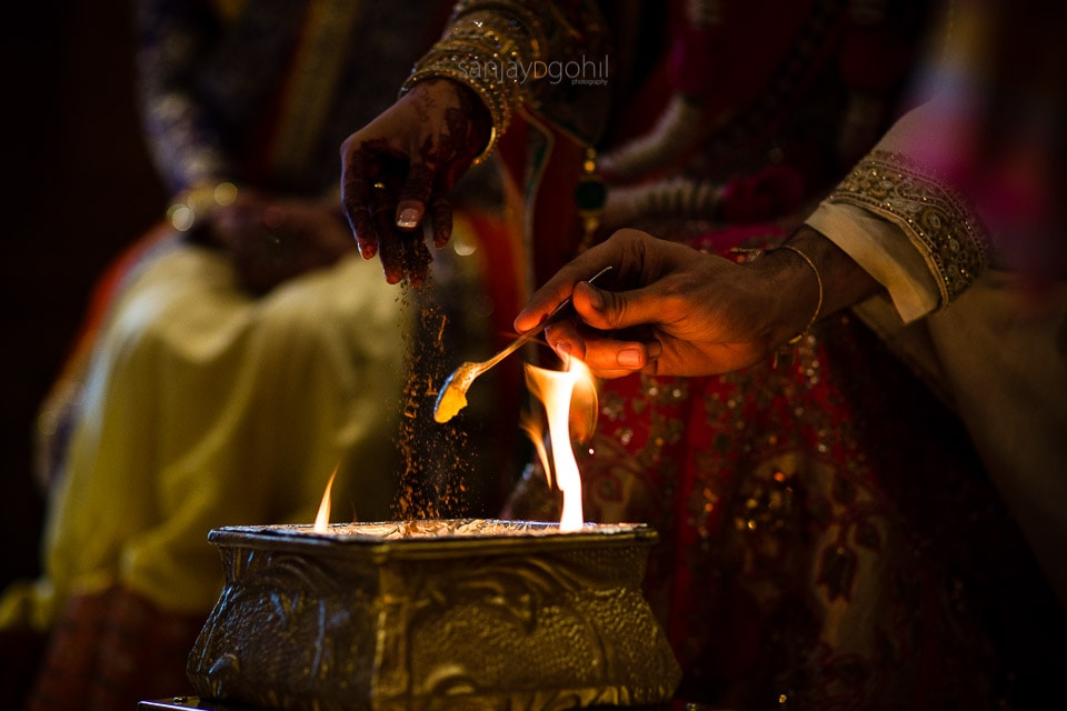 Ghee and seeds being poured into the fire
