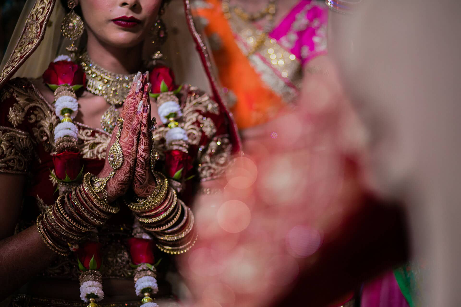 Bride praying during Hindu wedding