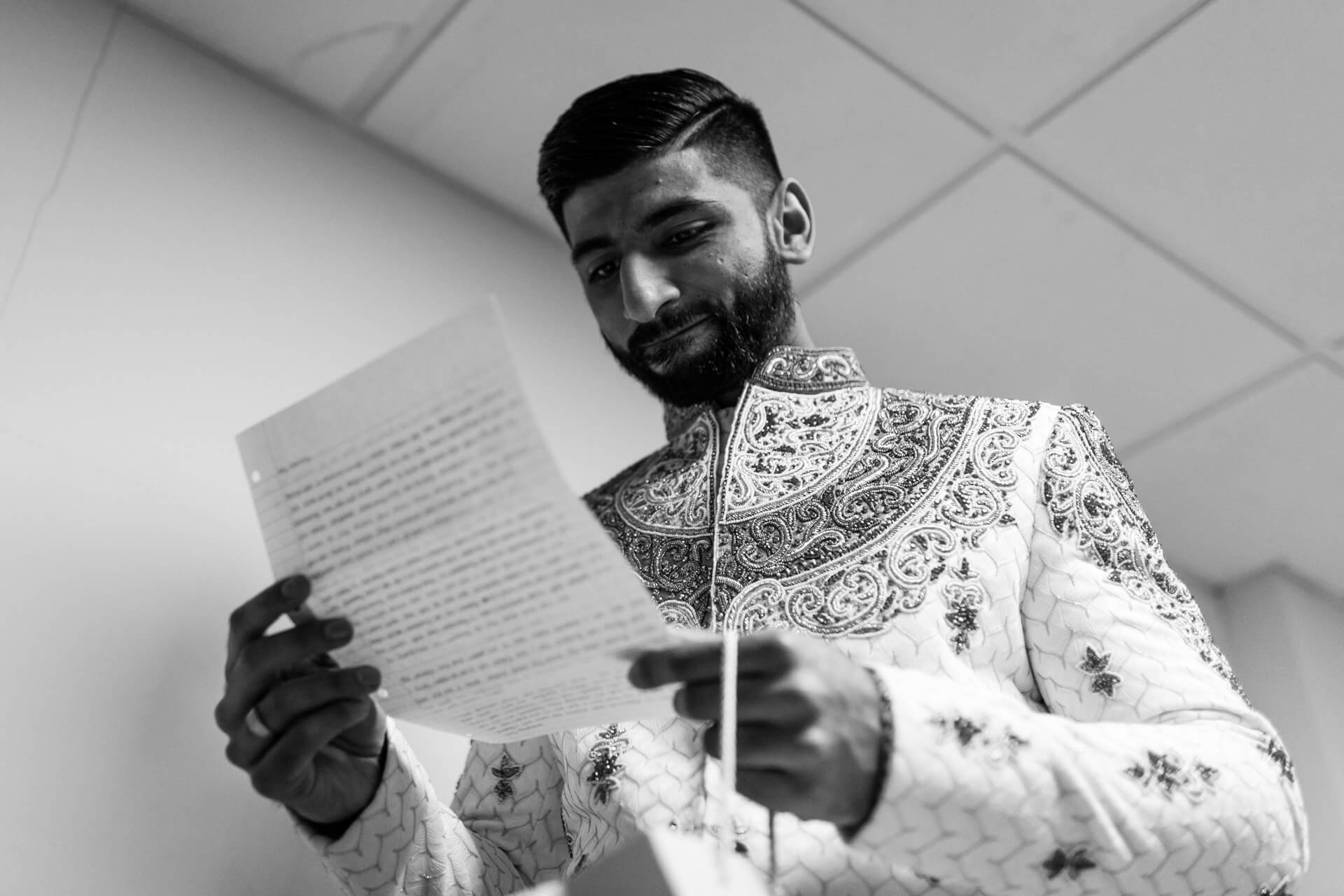 Groom reading personal letter