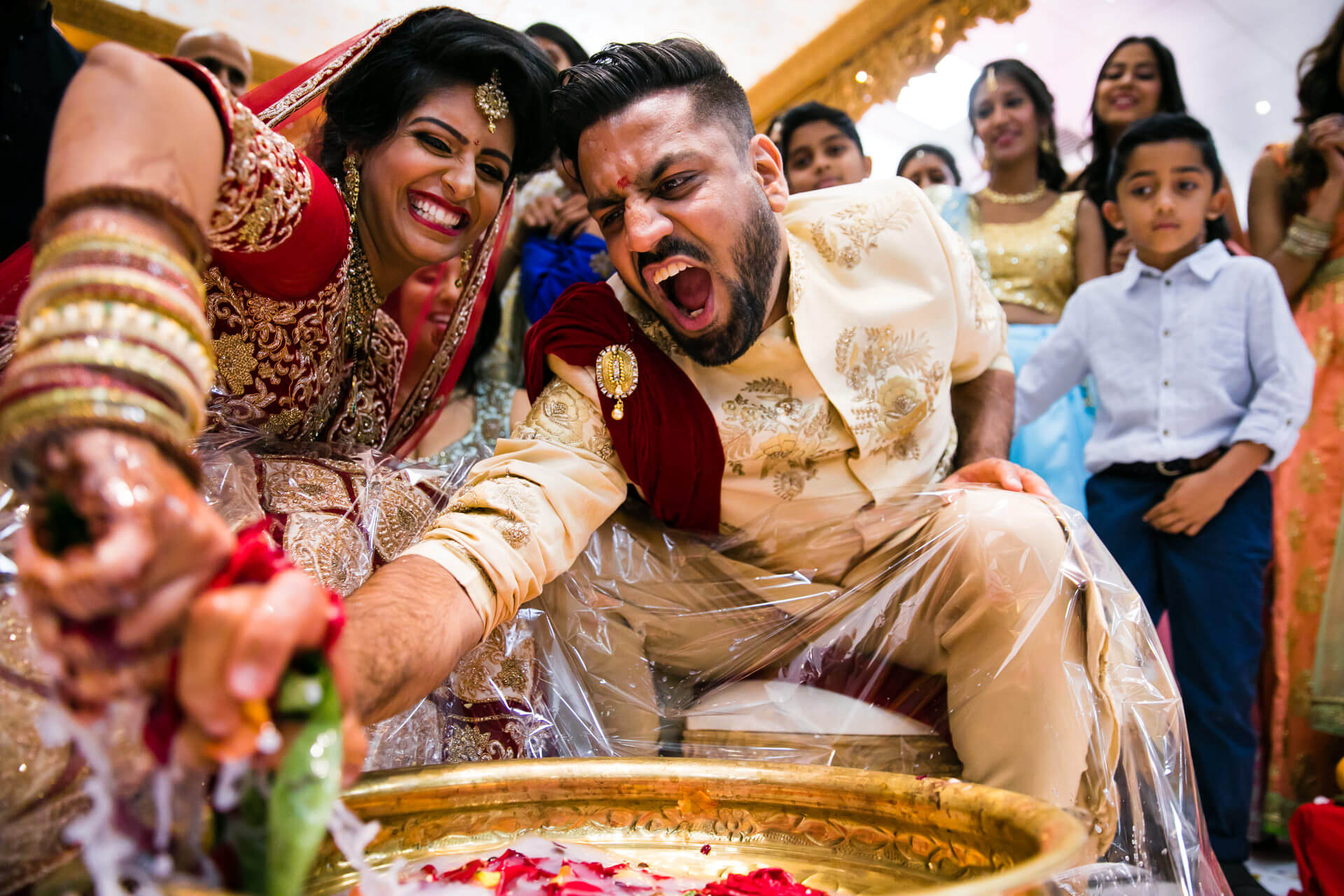 Bride and groom playing kodi kodi