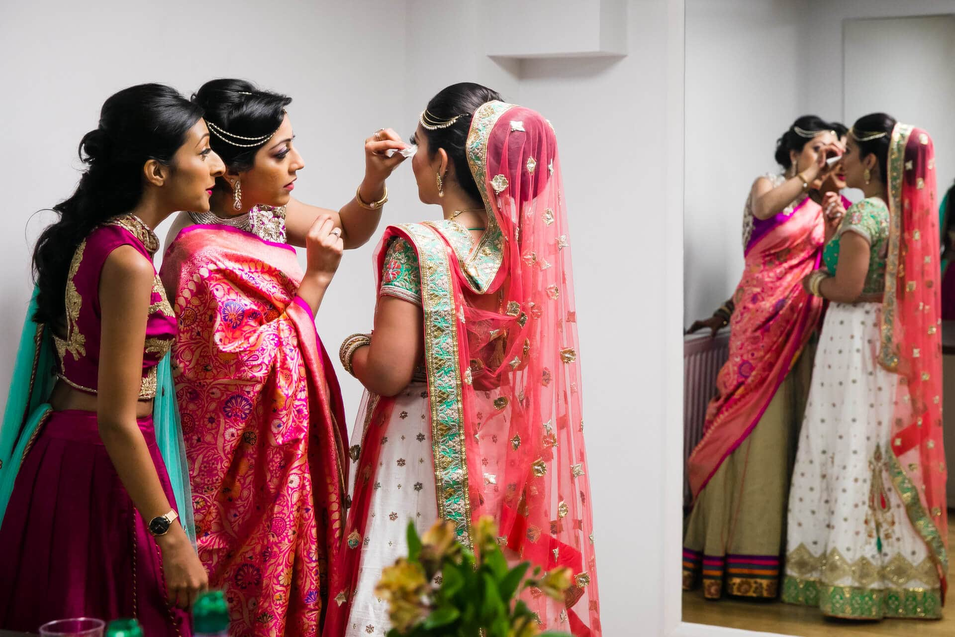 Sisters wiping bride's tears