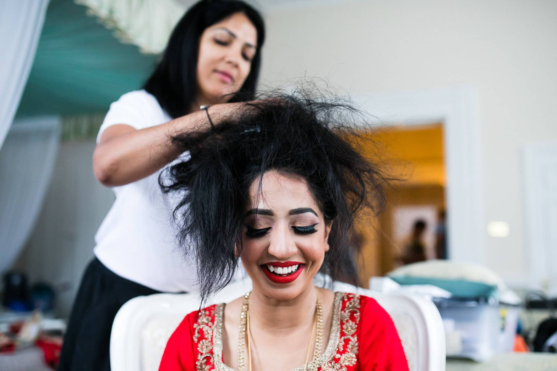 Roshni MUA getting bride ready for wedding