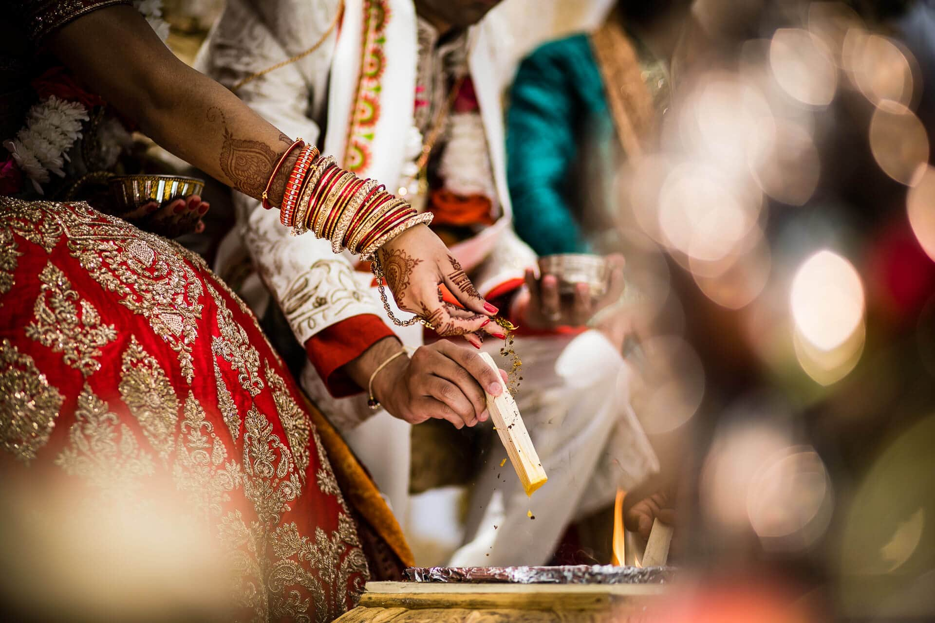 Seeds being poured into the fire during Hindu wedding