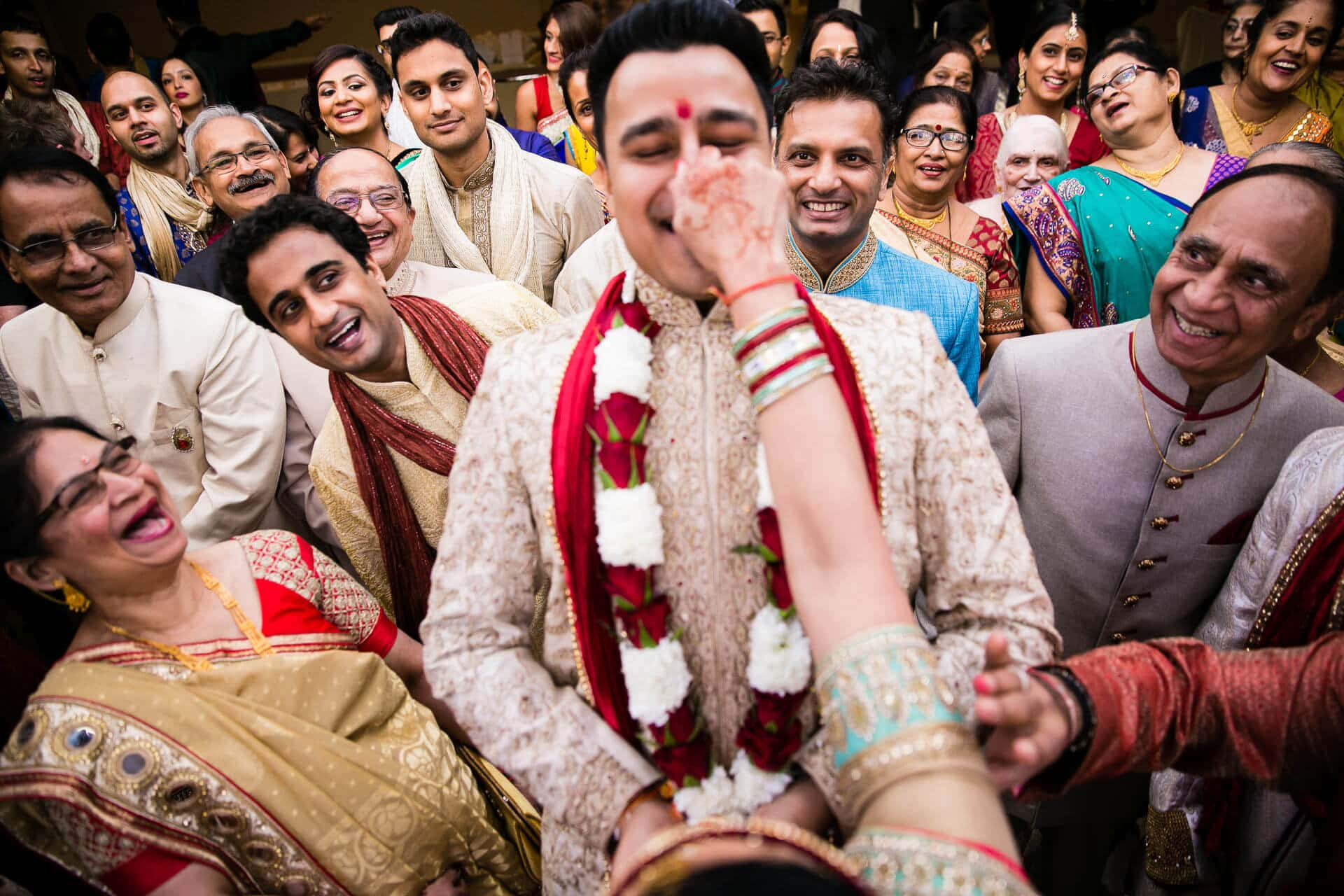 Groom's nose being pulled at Hindu Wedding