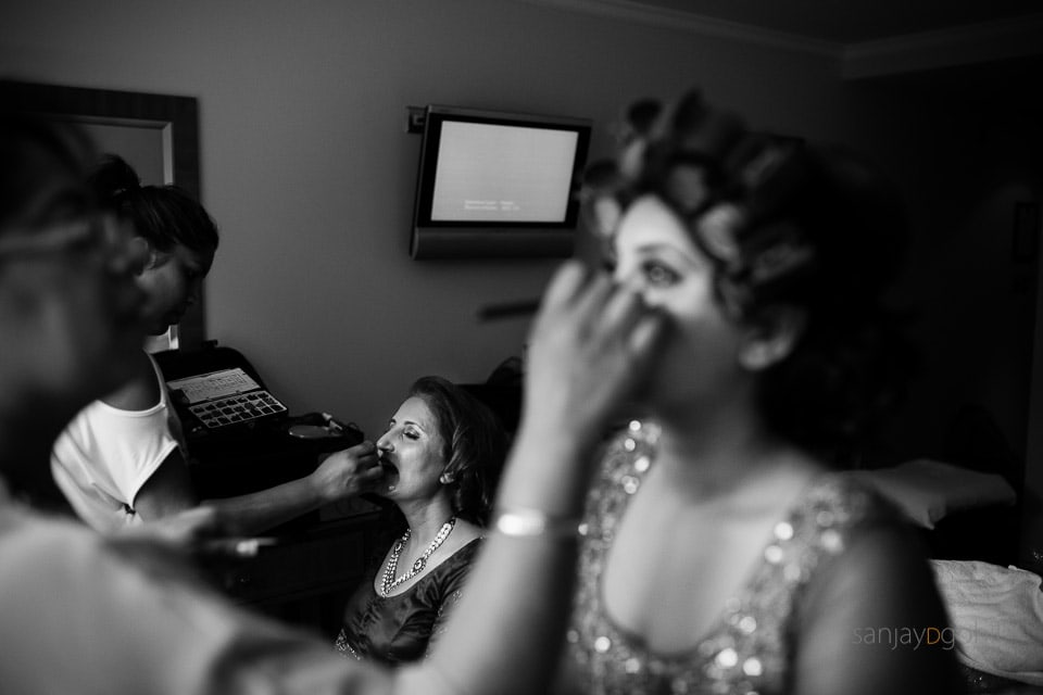 Asian Bride and Mother getting ready before wedding
