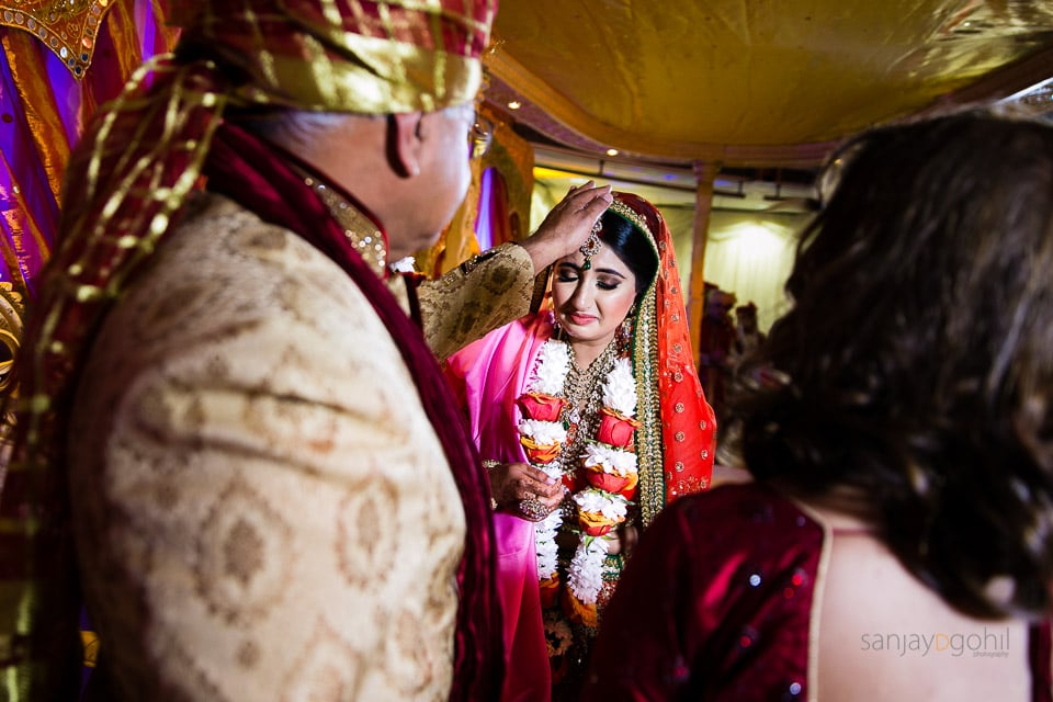 Hindu bride getting blessings from parents