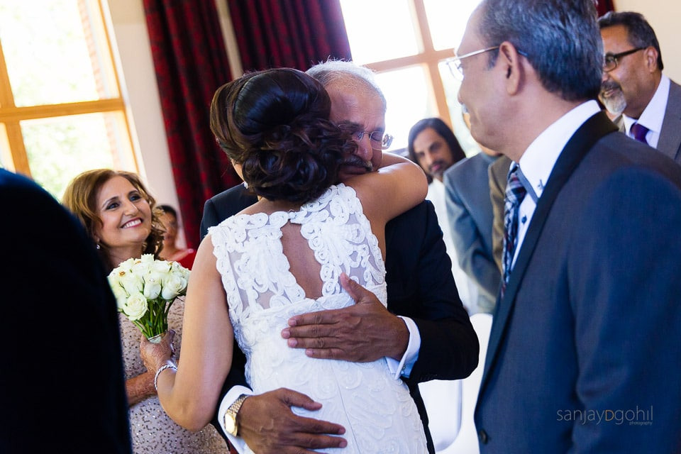 Father of the bride hugging is daughter
