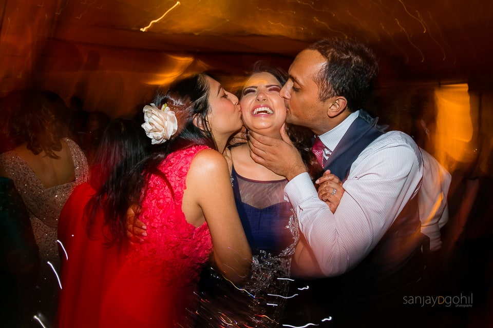 Guests dancing during wedding reception party at Savill Court, Windsor
