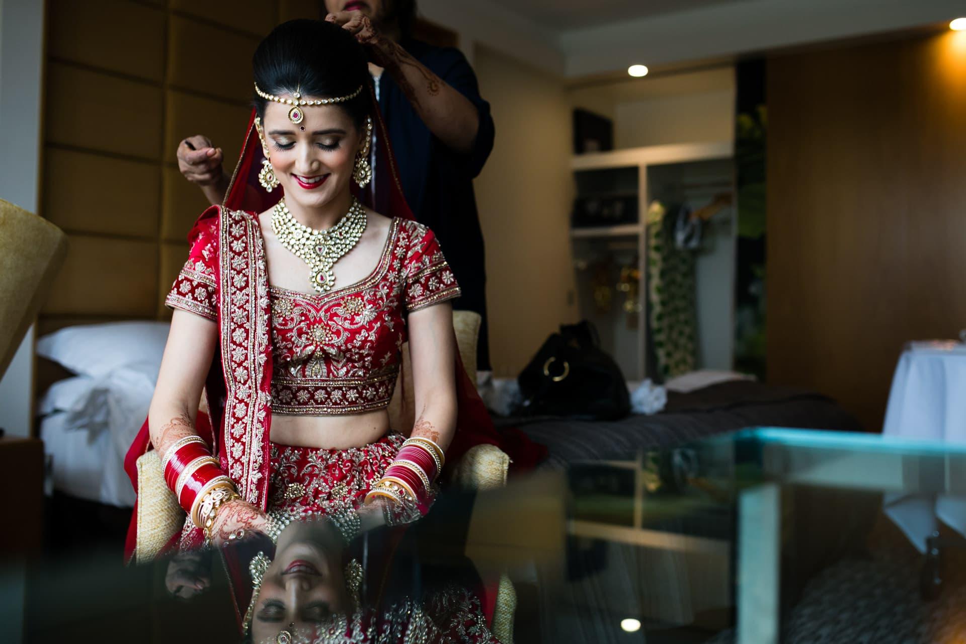 Hindu Asian Bride getting ready before wedding