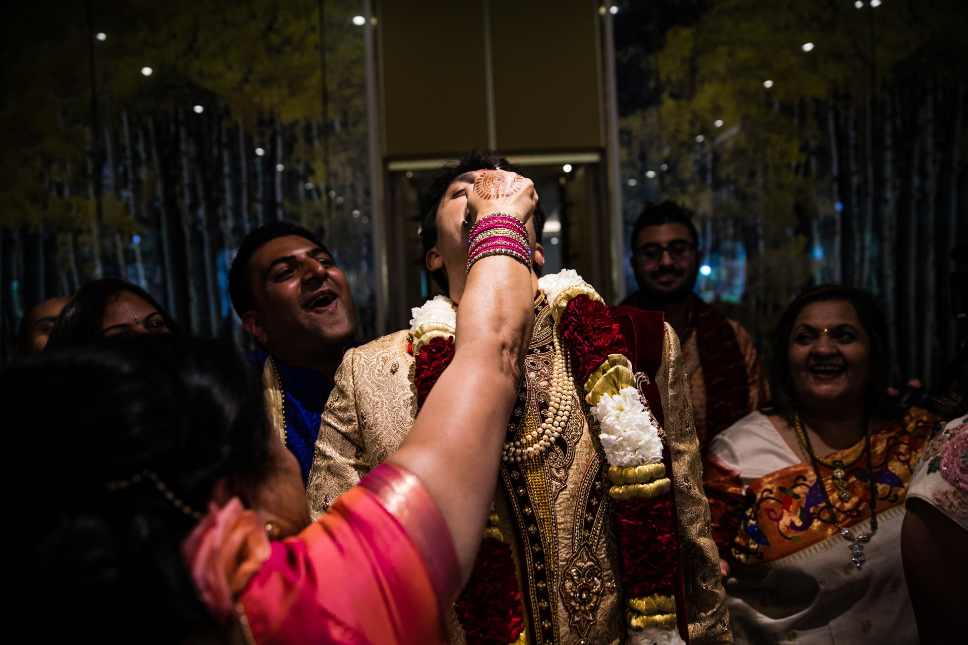 Groom having his nose pinched