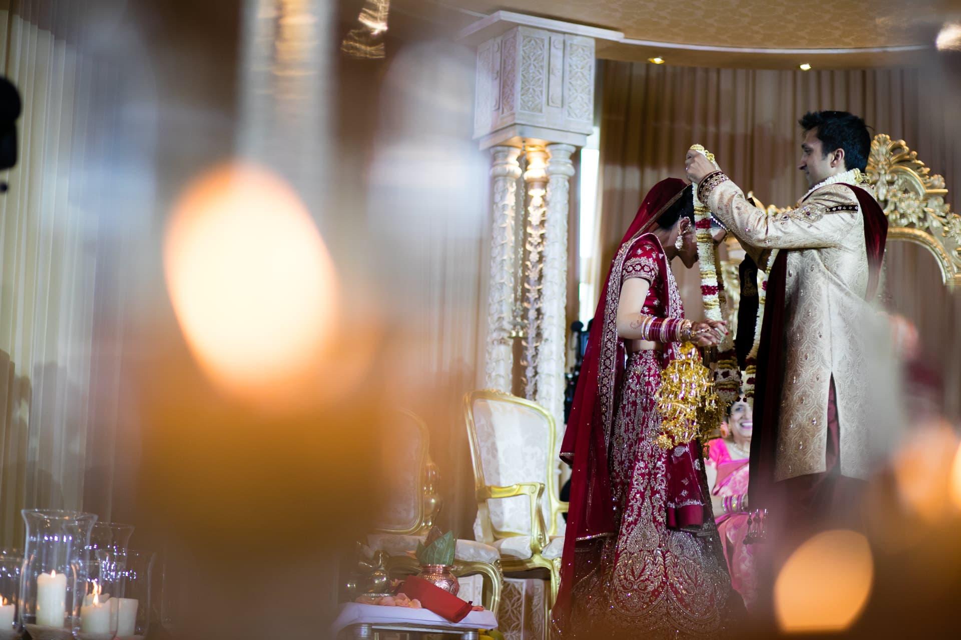 Groom garlanding Bride