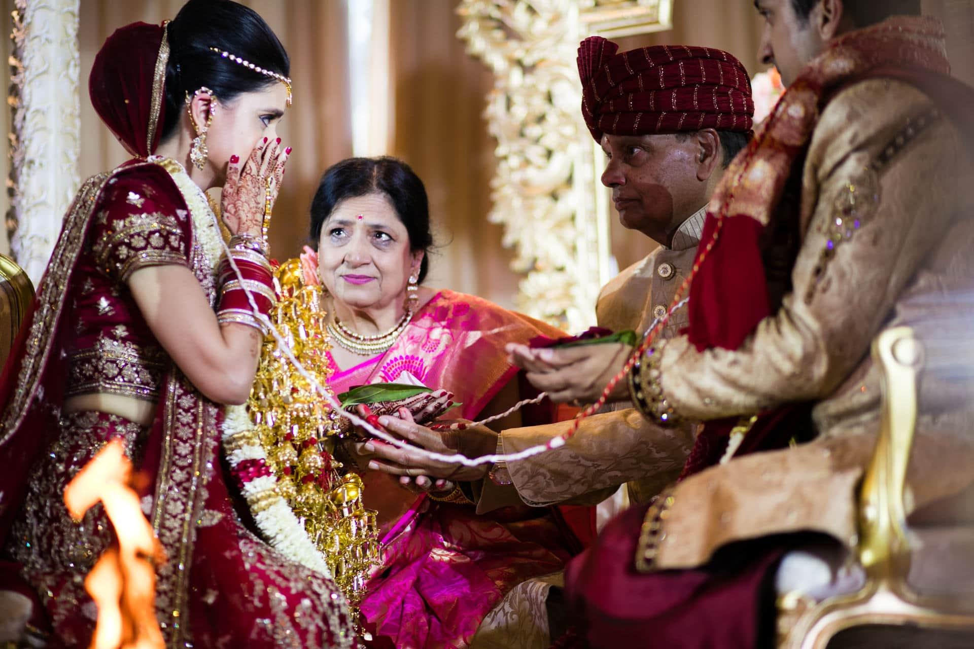 Bride wiping her tears