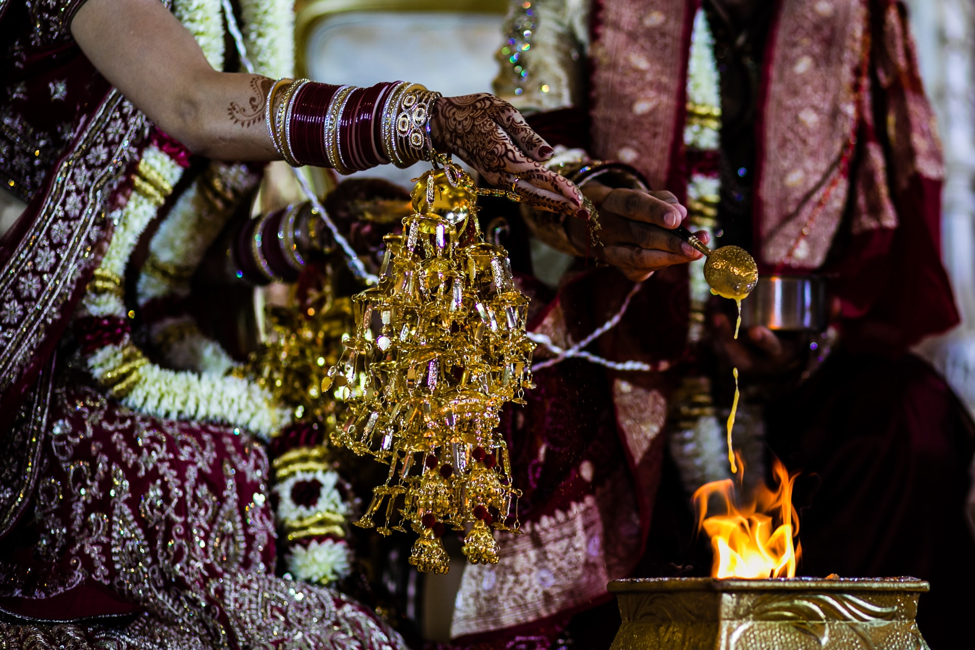 Ghee and seeds being poured into the fire during mandap ceremony