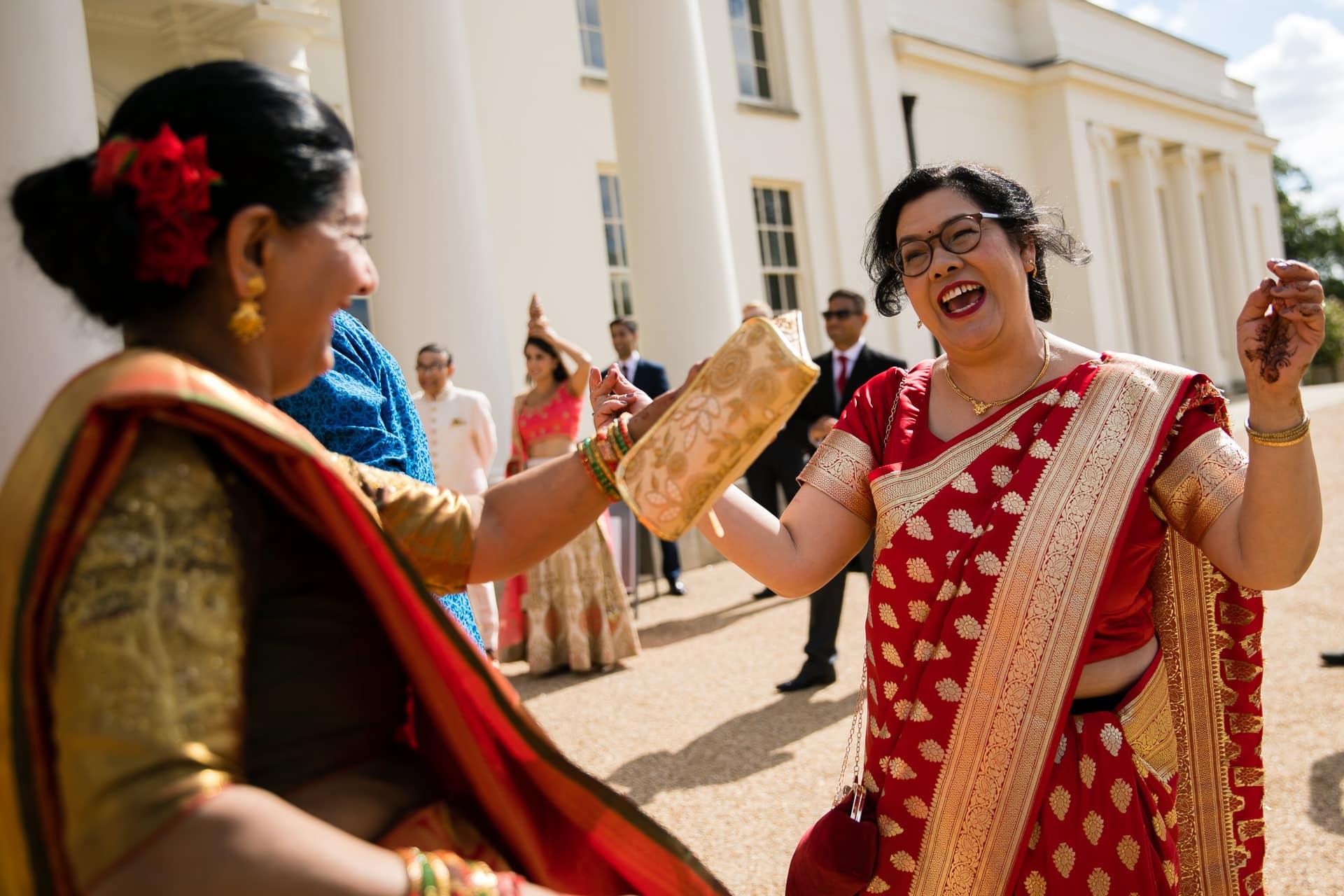 Mothers of bride and groom dancing