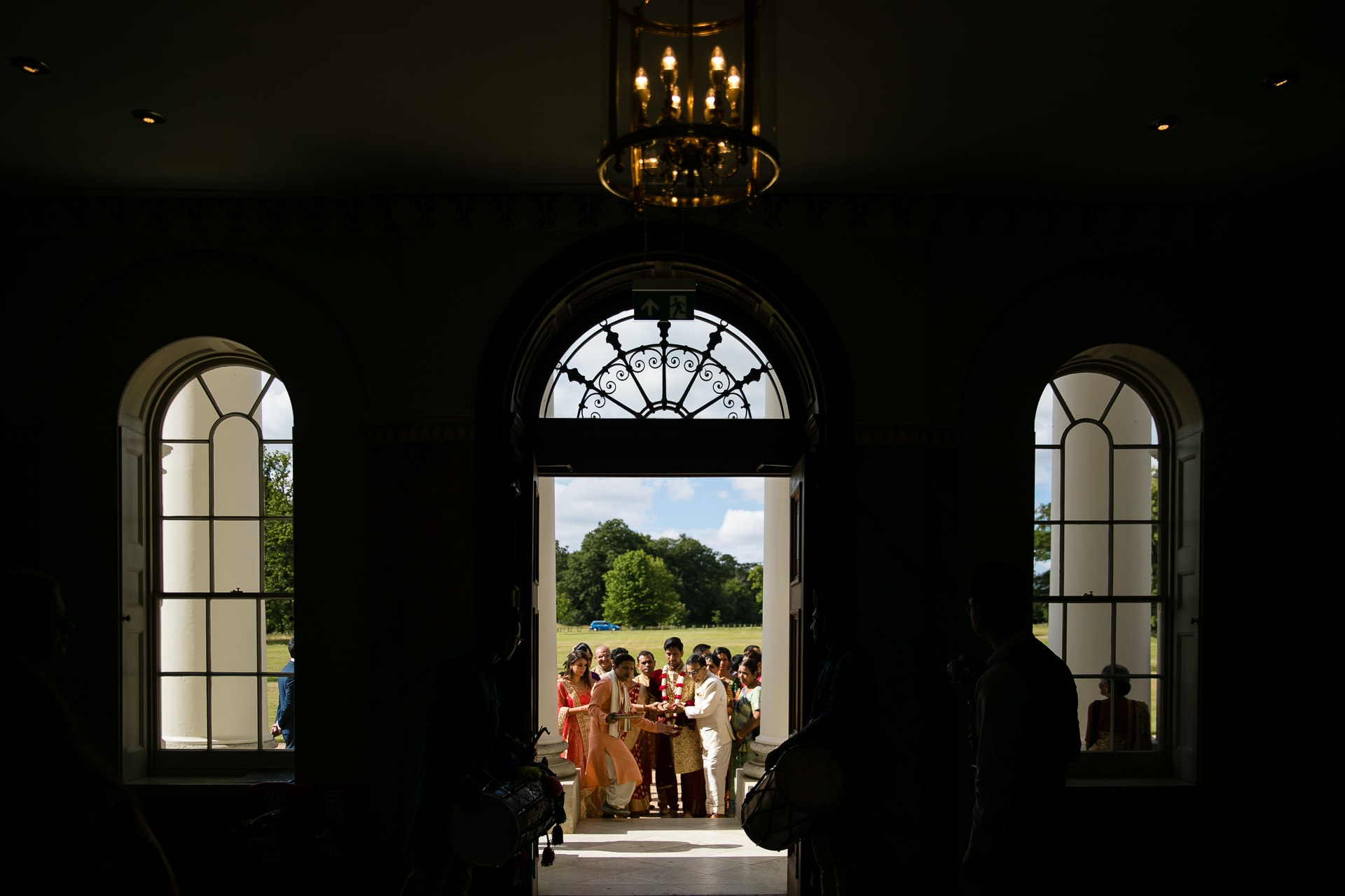 Wedding party walking into Hylands House