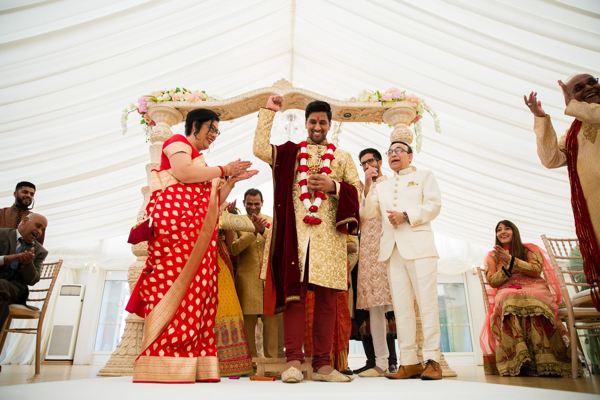 Groom stepping on clay pot