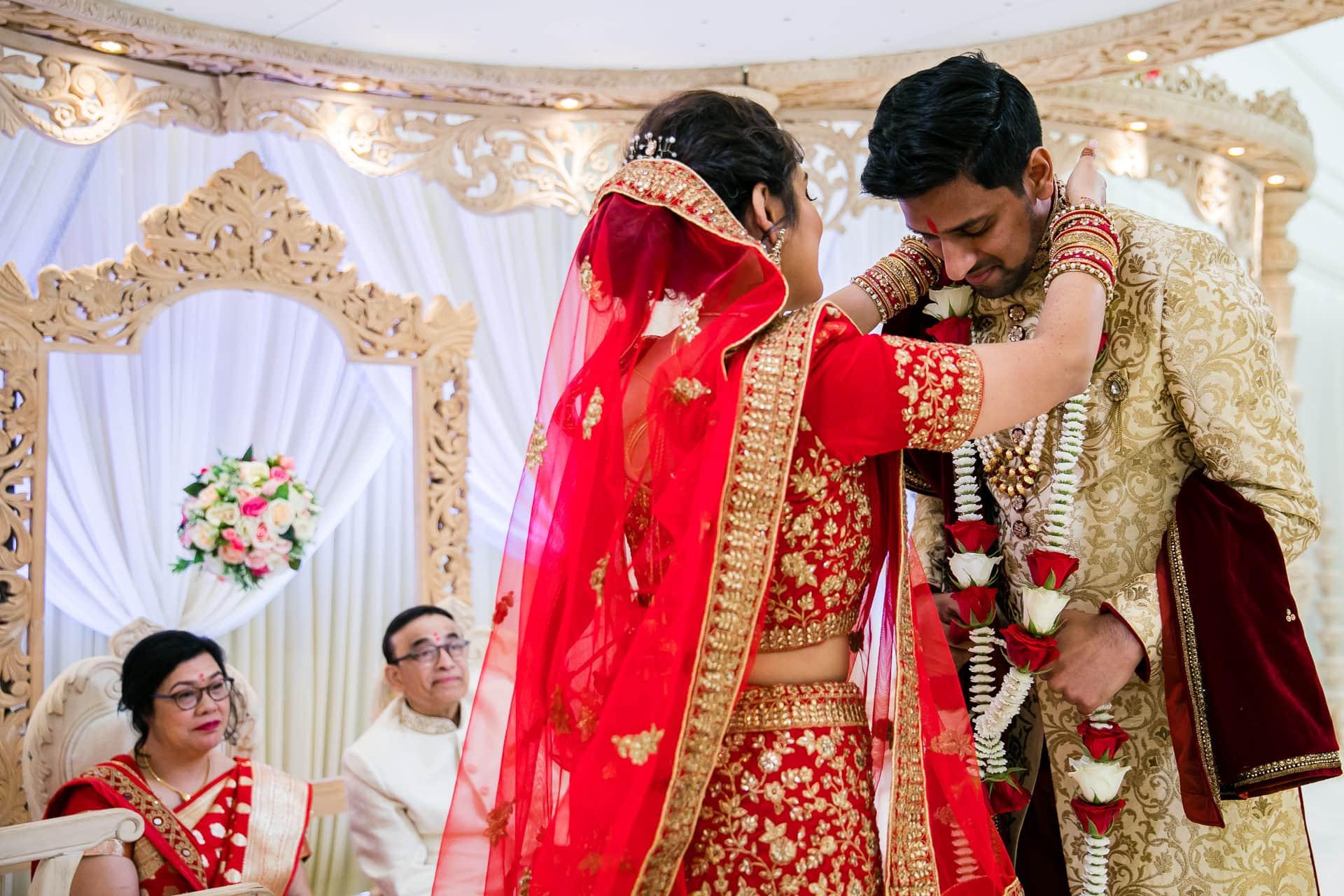 Garlanding ceremony during Gujarati wedding