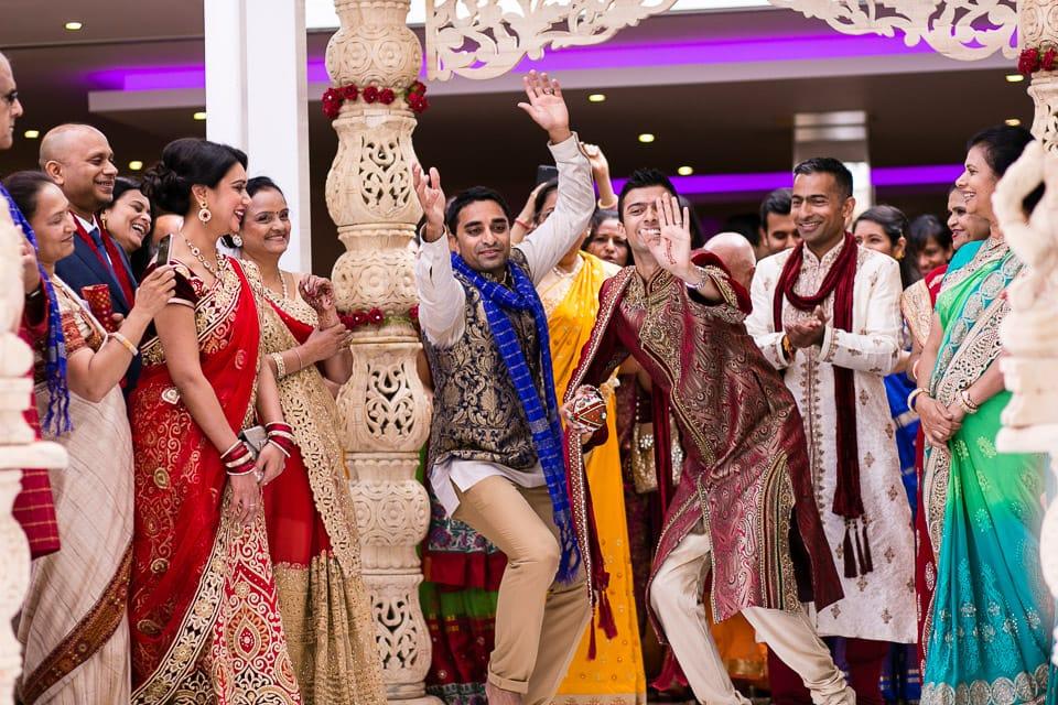 Hindu groom dancing up the isle way