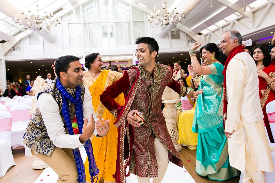 Hindu groom dancing up the isle way