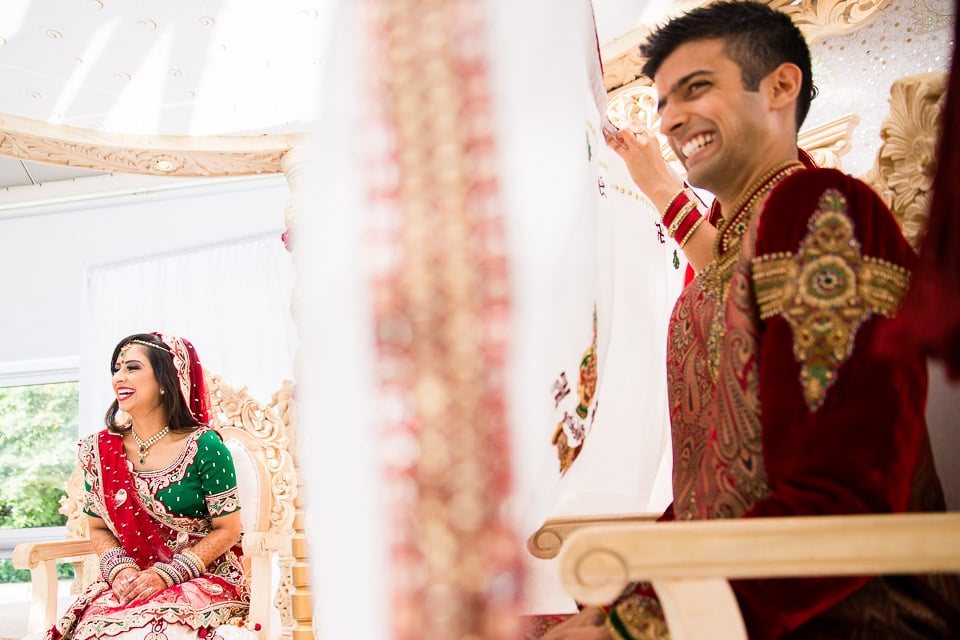 Bride and groom laughing being the antaphat
