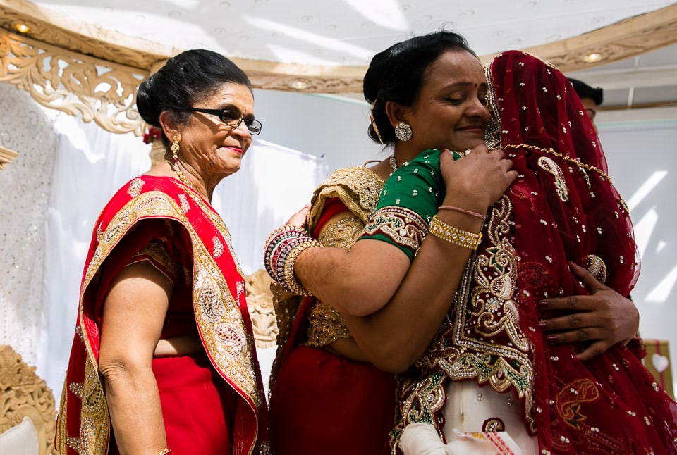 Bride hugging family members