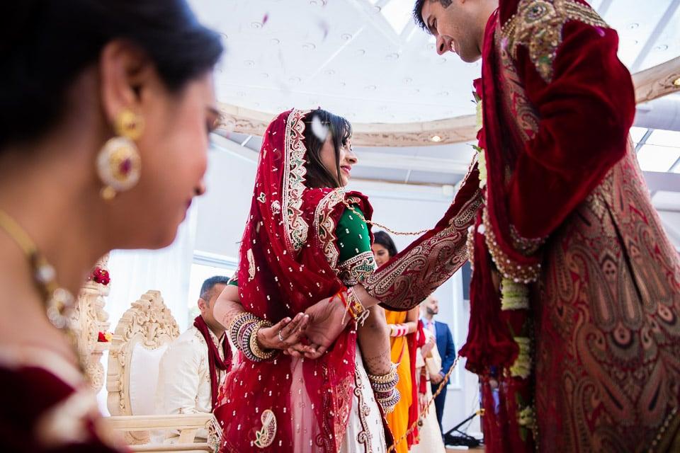 Hind Wedding bride leading the phera