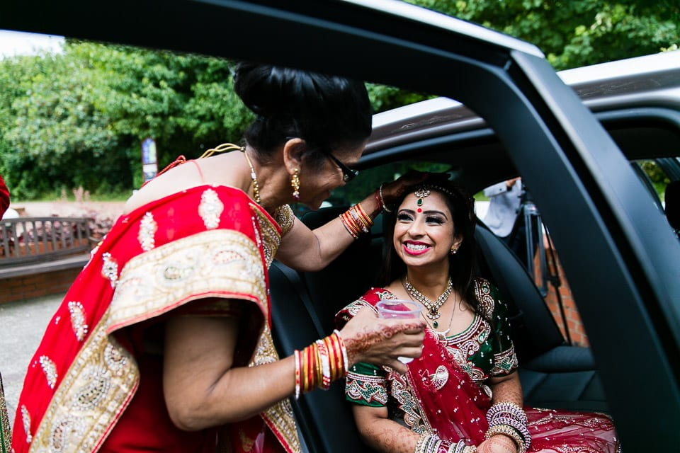 Hindu bride smiling at mother