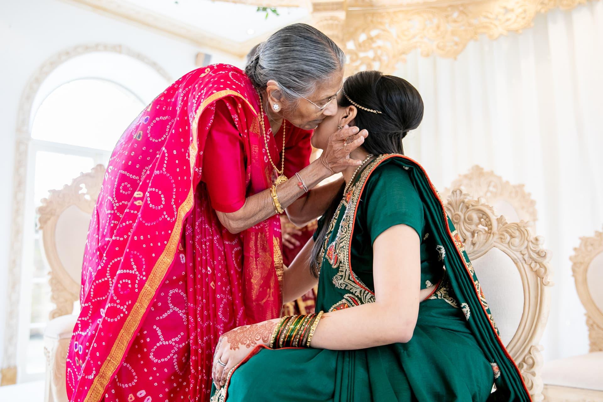 Grandmother kissing bride