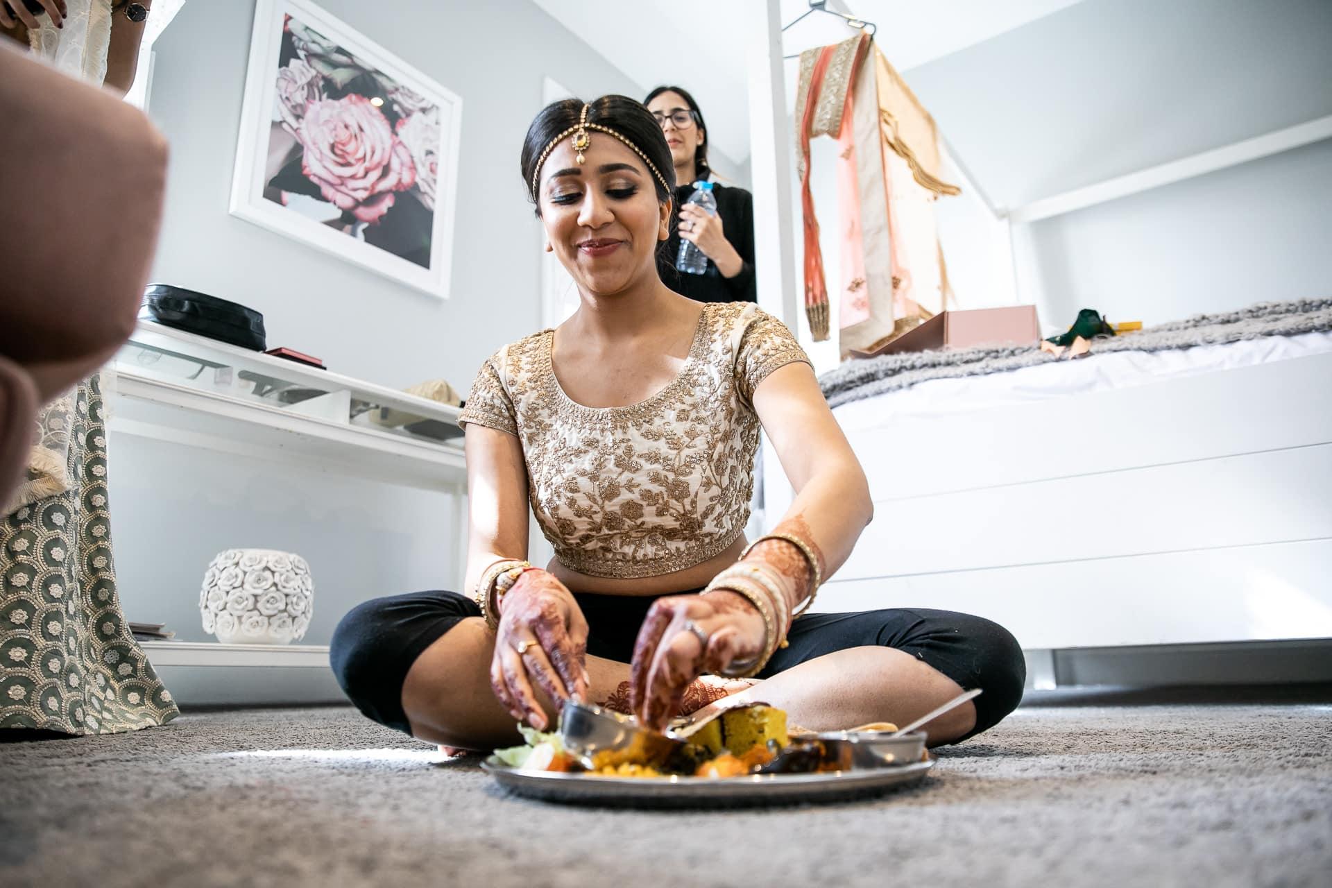 Asian bride eating