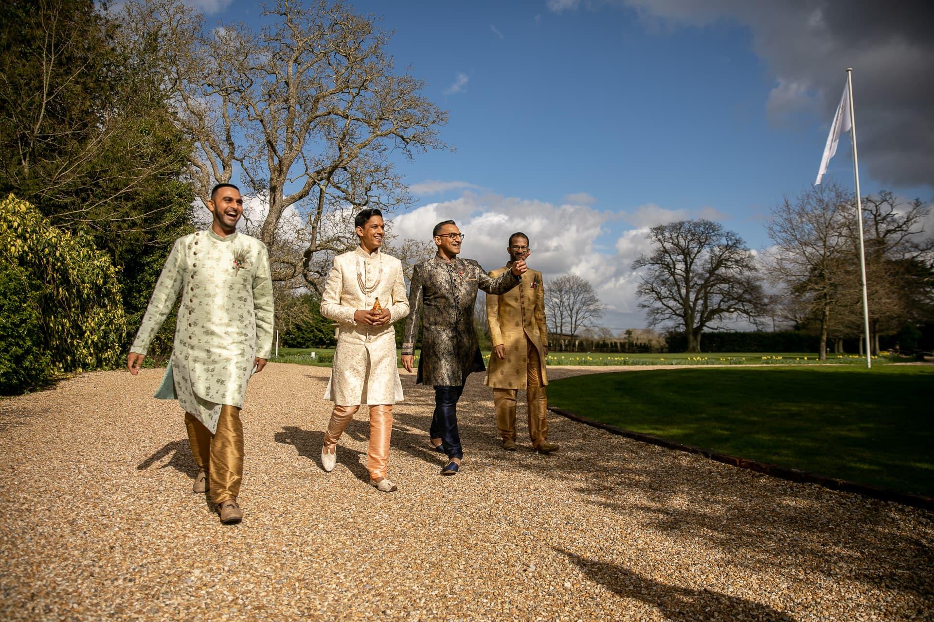 Groom arriving for wedding with best men