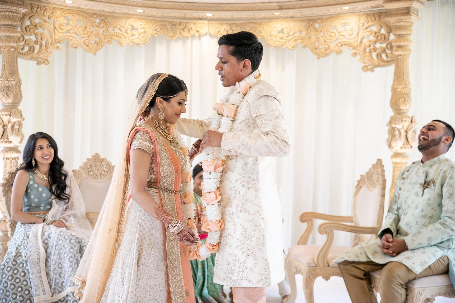 Bride and groom garlanding ceremony