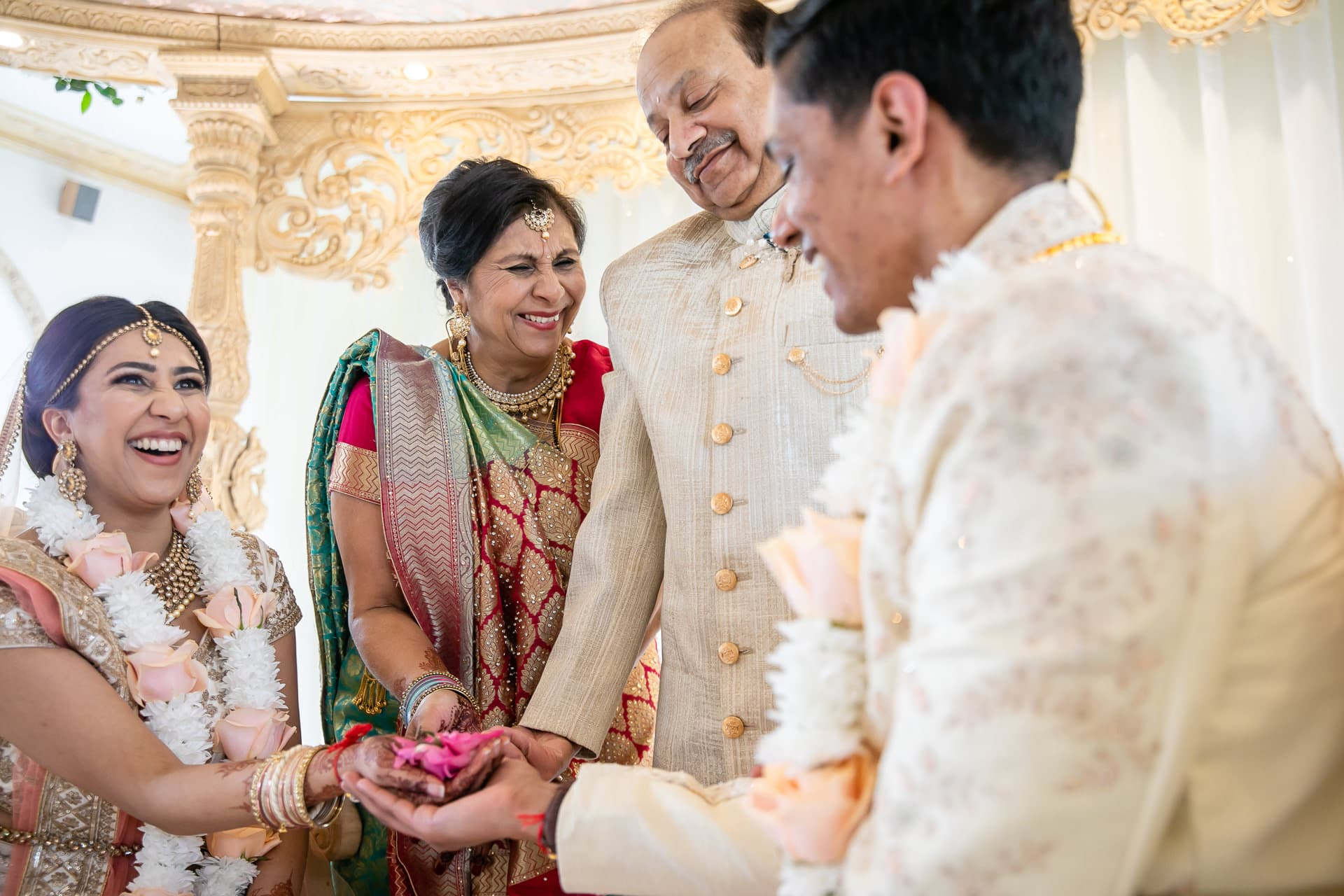 Parents of the bride giving bride's hand away in marriage