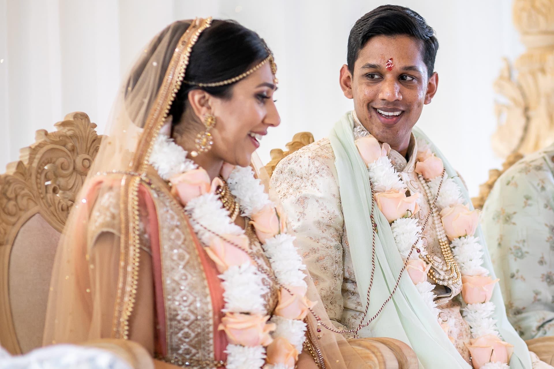 Hindu Groom looking at bride smiling
