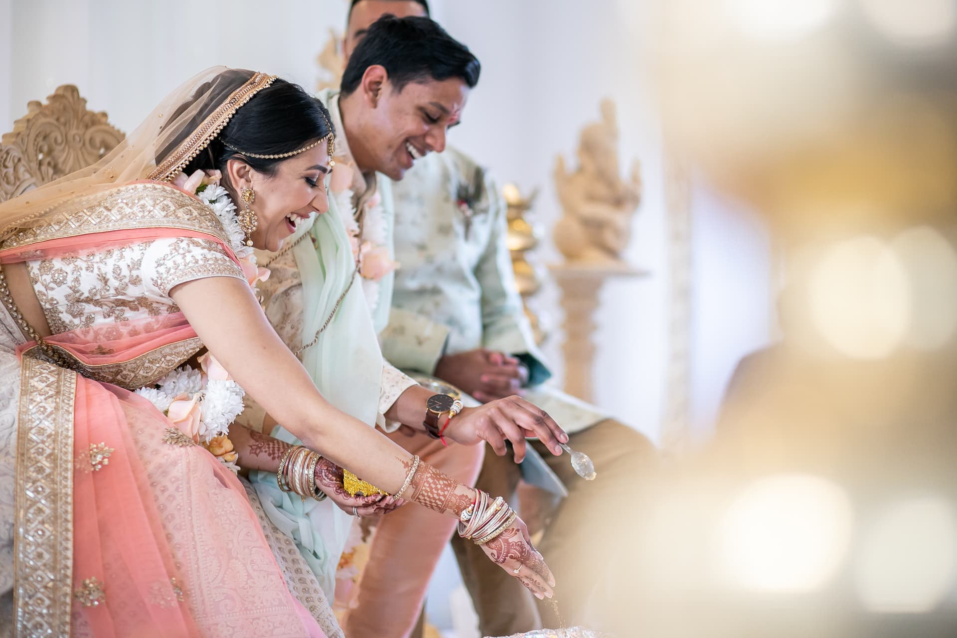 Bride and groom feeding fire