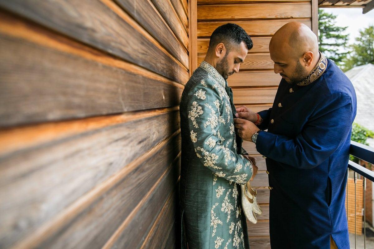 Asian Groom getting ready for Hindu wedding ceremony