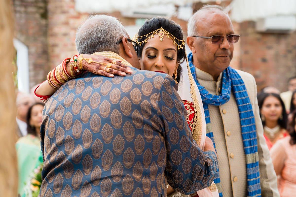 Bride hugging her uncles