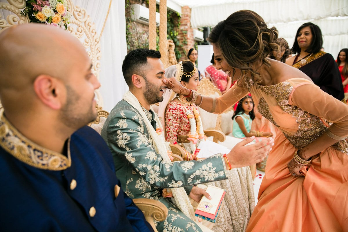 Groom's nose being pinched