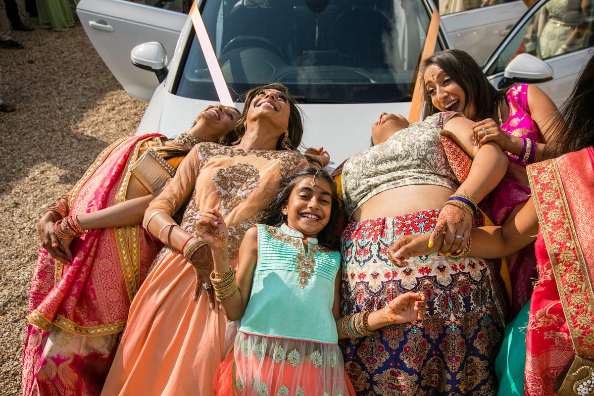 Brides' sister lying on the car