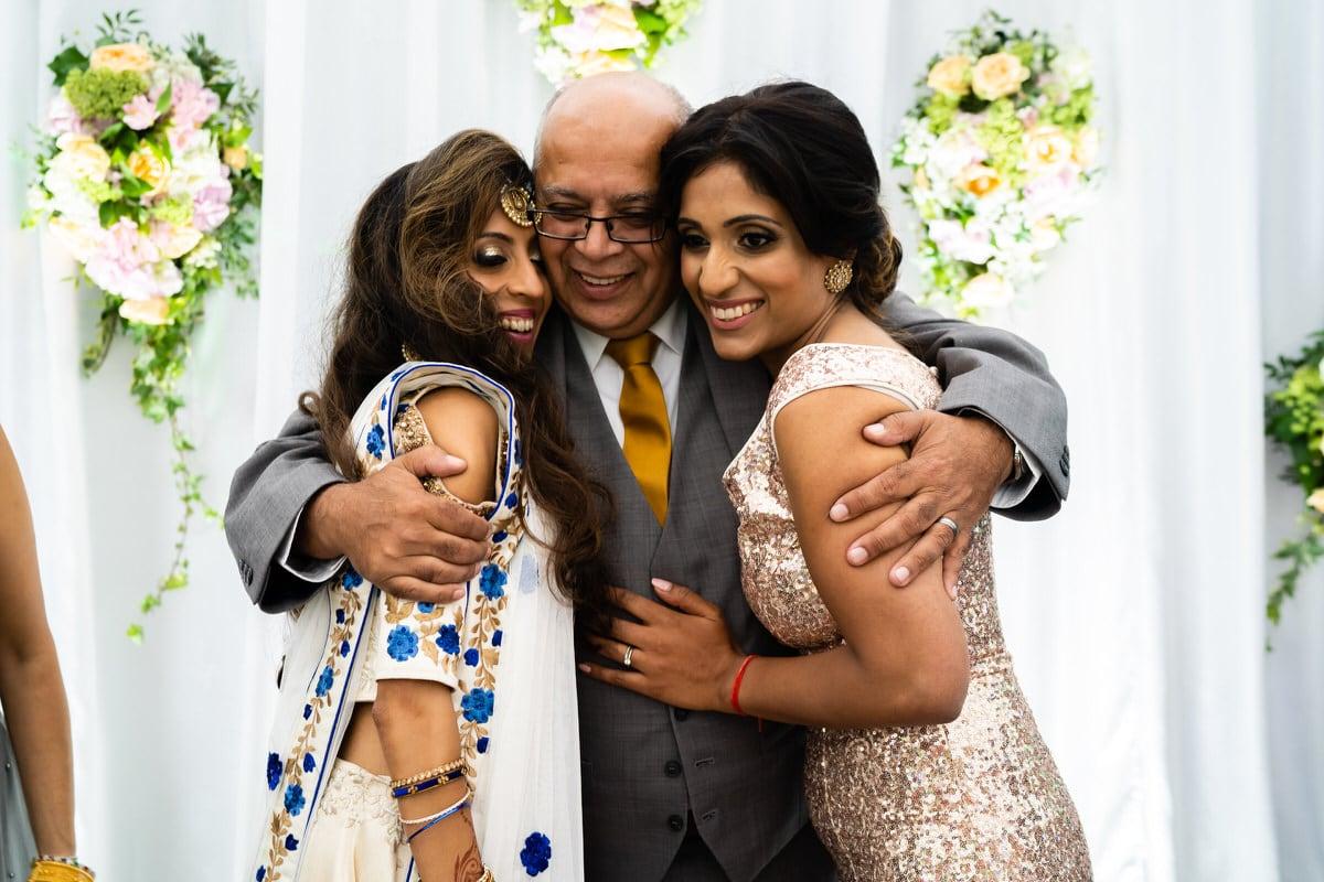 bride hugging family members at wedding