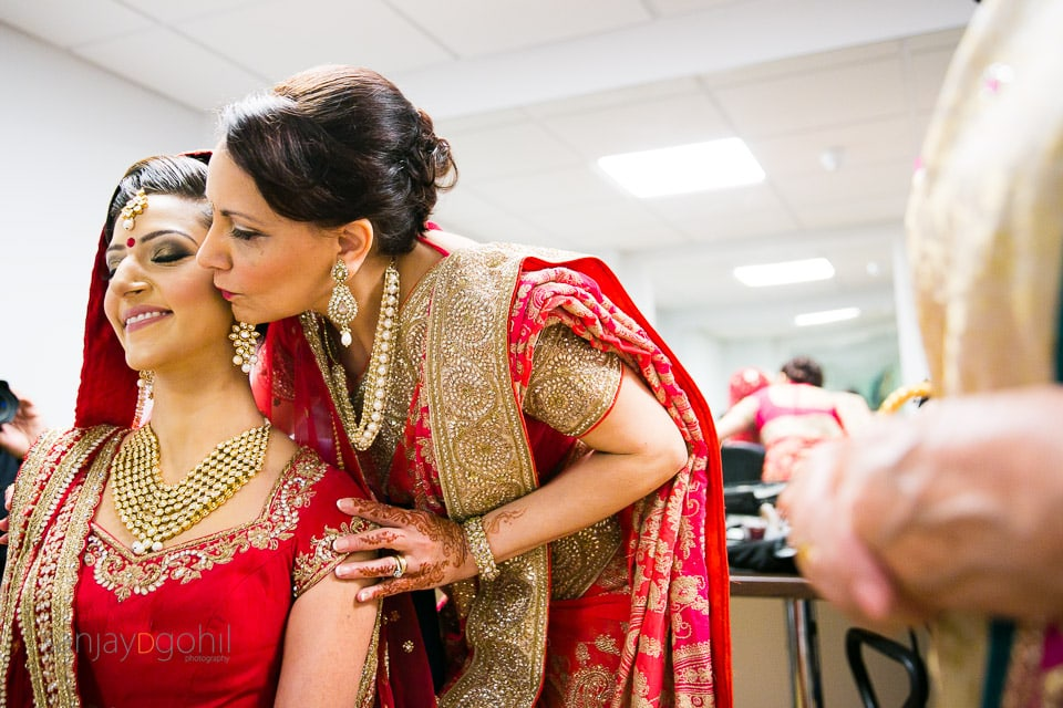 Mother of the bride kissing daighter