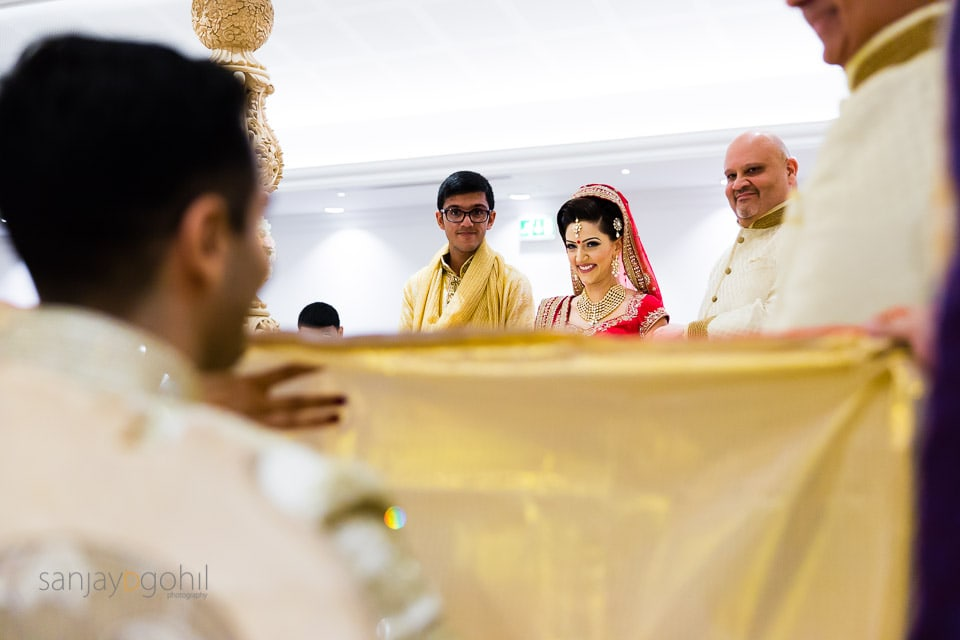 Hindu Bride smiling as she she sees the groom
