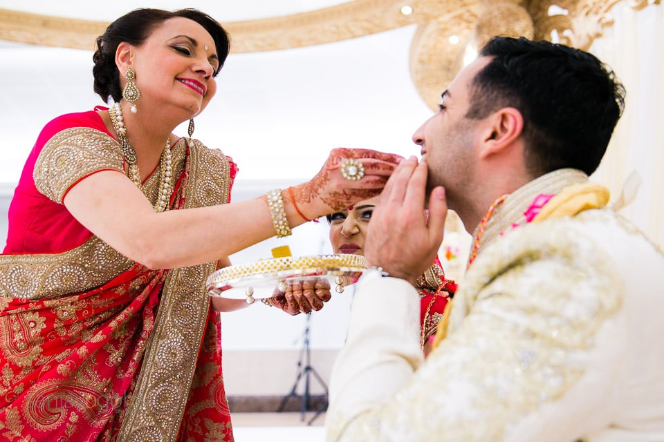 Groom being fed during wedding ceremony
