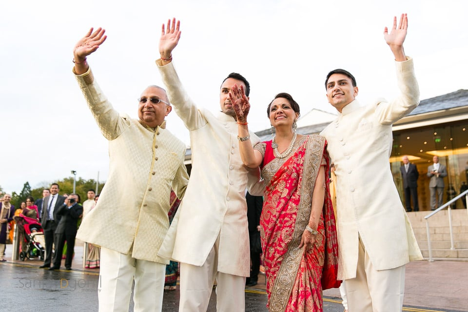 Bride's family waving goodbye