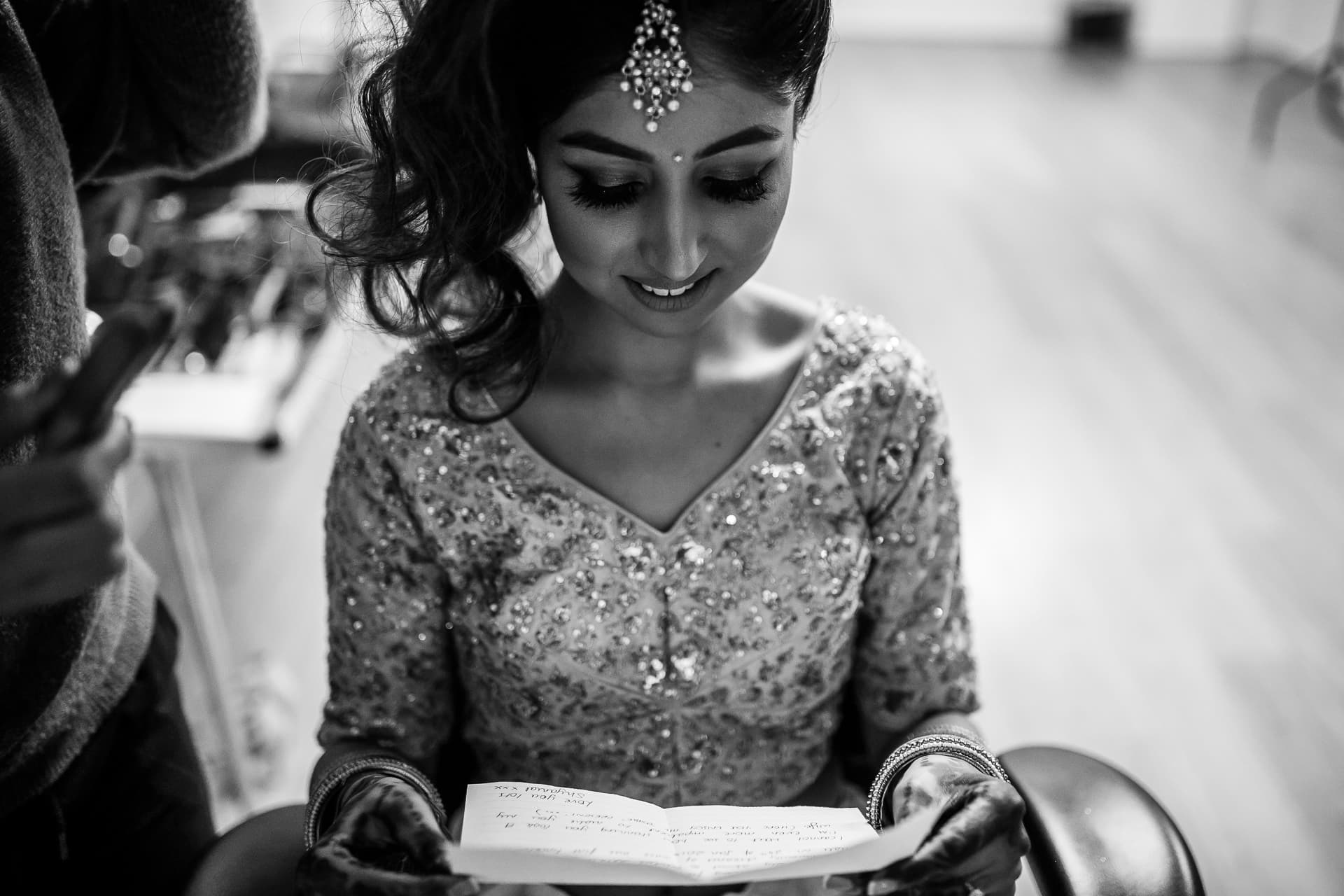 Asian Wedding Bride reading love letter