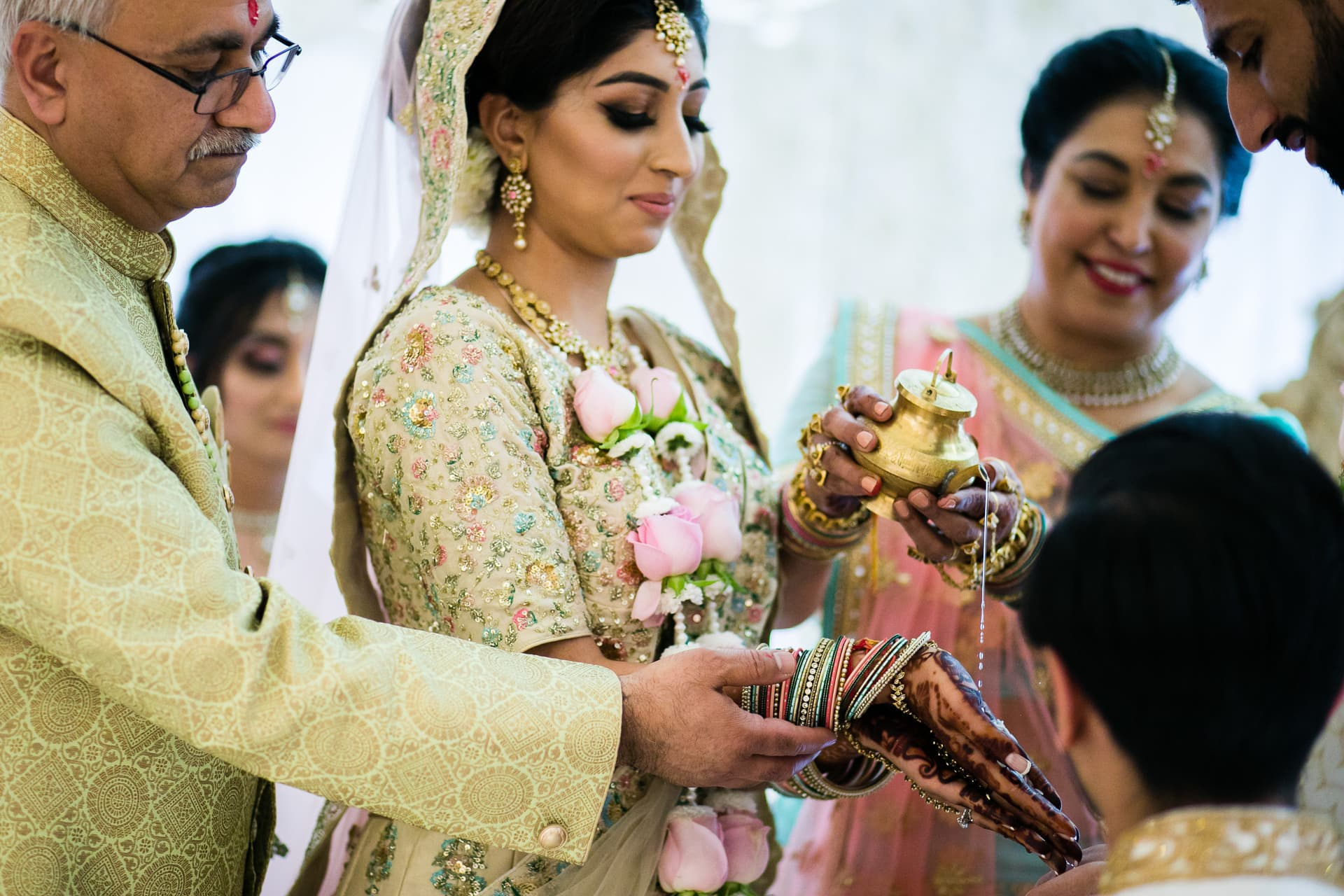 Bride's parents giving daughter away in marriage