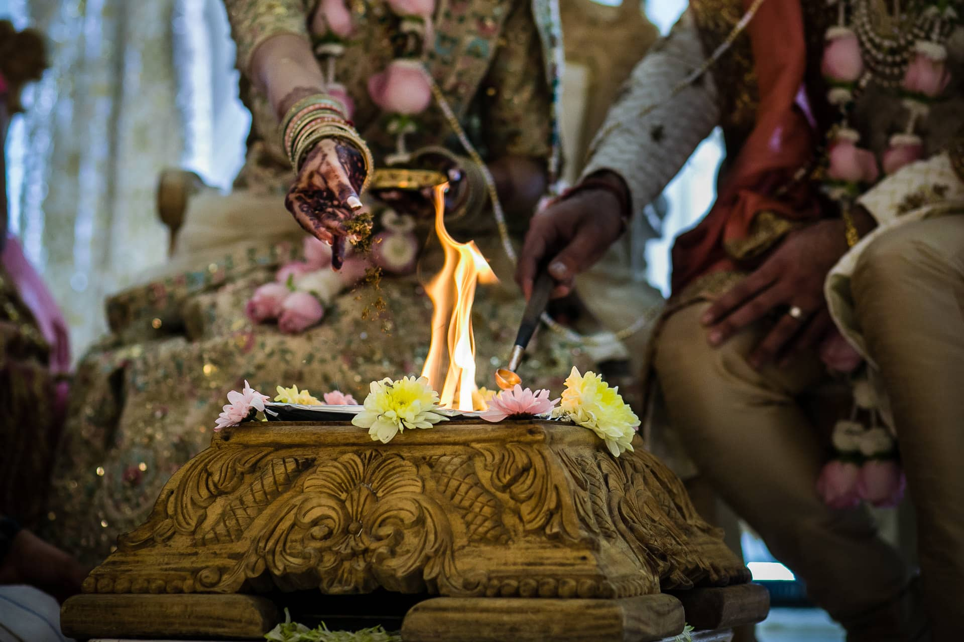 Seeds being poured into the fire during wedding ceremony