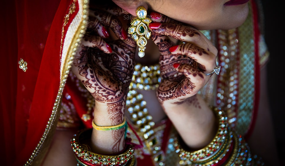 Indian Bride getting ready putting earrings on